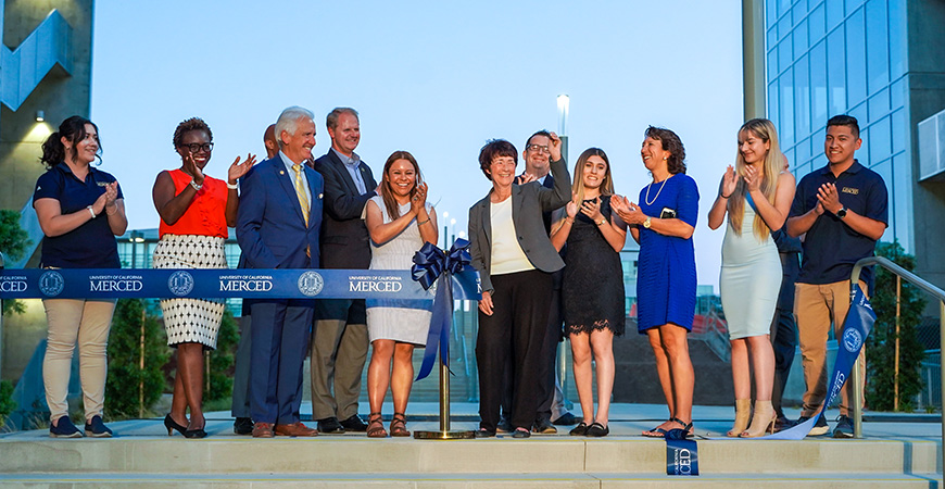 Outgoing Chancellor Dorothy Leland cut the ribbon to signify the opening of the second phase of the Merced 2020 Project.
